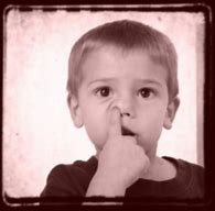 boy with finger up nose